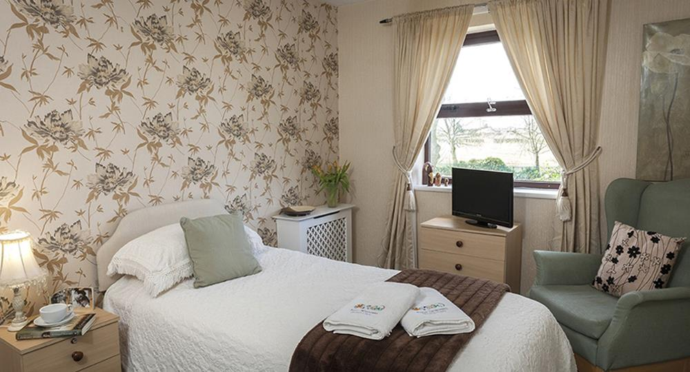 bedroom of a care home in Radcliffe
