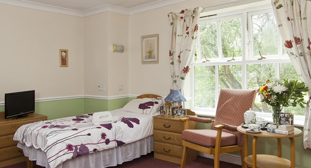 bedroom of a care home in Salford