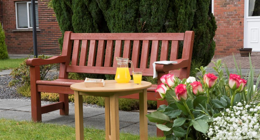 garden area of a care home in Preston